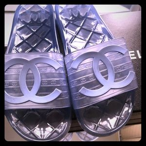 Chanel clear blue pool slides.